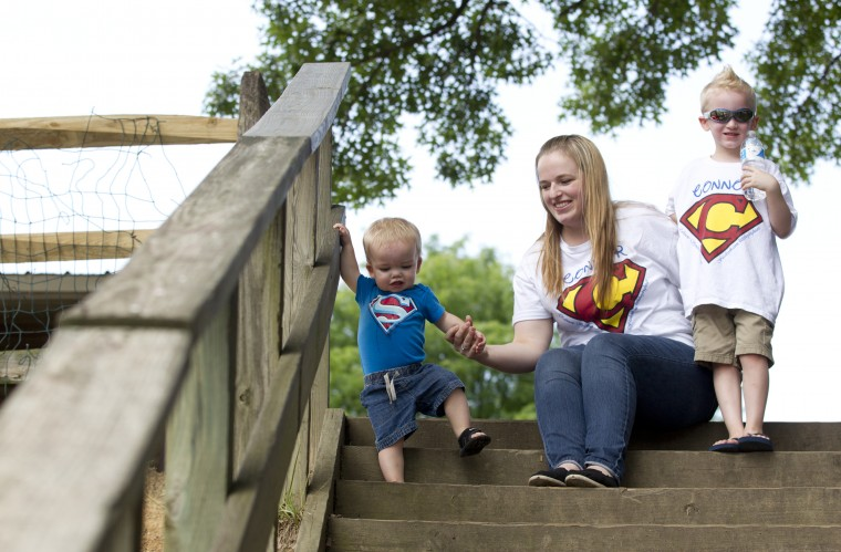 Connor Berry, 22 months, of Lansdowne takes off down some stairs while trying to pose for a photo with his brother Camden Berry, right, 5, and mother Caitie Berry, center, at while at Hillcrest Park in Lansdowne, MD on Thursday, July 3, 2014. (Jen Rynda/BSMG)