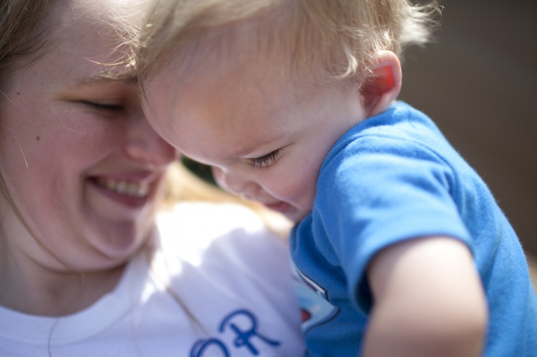 Connor Berry, 22 months, of Lansdowne plays at Hillcrest Park with his mother Caitie Berry in Lansdowne, MD on Thursday, July 3, 2014. (Jen Rynda/BSMG)