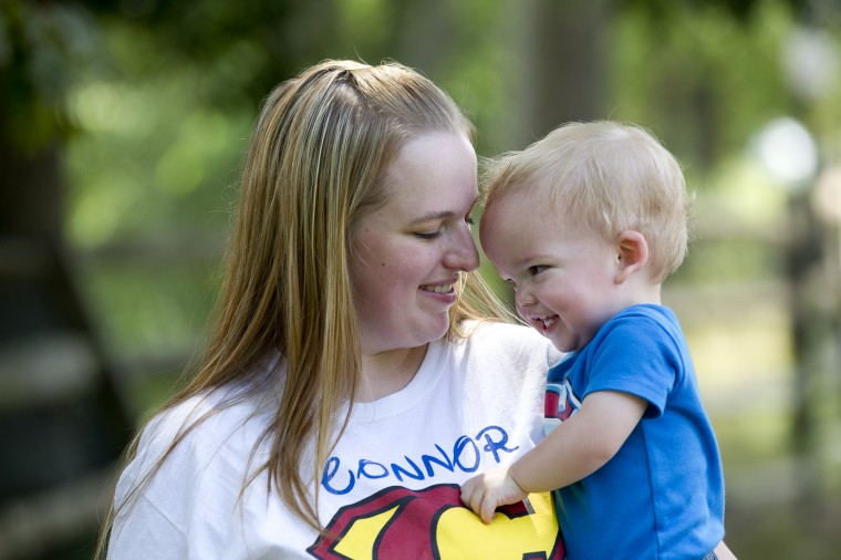 Caitie Berry of Lansdowne poses for a photo with son Connor Berry, 22 months, at Hillcrest Park in Lansdowne, MD on Thursday, July 3, 2014. (Jen Rynda/BSMG)