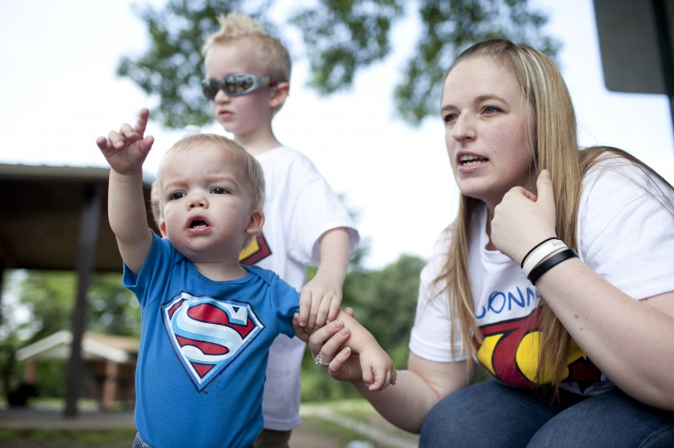 Connor Berry, left, 22 months, of Lansdowne points out some ducks while at Hillcrest Park with his brother Camden Berry, 5, their mother Caitie Berry in Lansdowne, MD on Thursday, July 3, 2014. (Jen Rynda/BSMG)
