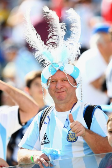 An Argentina fan enjoys the atmosphere prior to the 2014 FIFA World Cup Brazil Round of 16 match between Argentina and Switzerland at Arena de Sao Paulo on July 1, 2014 in Sao Paulo, Brazil. (Jamie Squire/Getty Images)
