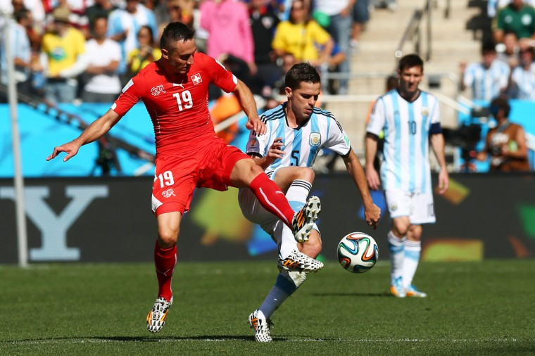 Josip Drmic of Switzerland and Fernando Gago of Argentina compete for the ball during the 2014 FIFA World Cup Brazil Round of 16 match between Argentina and Switzerland at Arena de Sao Paulo on July 1, 2014 in Sao Paulo, Brazil. (Ronald Martinez/Getty Images)