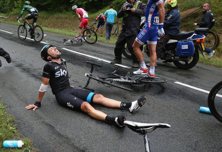 Xabier Zandio of Spain and Team Sky lies on the ground after being involved in a crash on the descent of the Cote de Coucy-le-Chteau-Auffrique which forced him to abandon the race during stage six of the 2014 Le Tour de France from Arras to Reims on July 10, 2014 in Coucy, France. (Doug Pensinger/Getty Images)