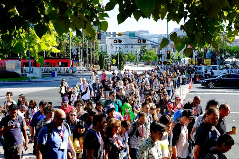 A crowd crosses the street in front of the San Diego Convention Center as fans head in for the first day of the 45th annual San Diego Comic-Con on July 24, 2014 in San Diego, California. An estimated 130,000 attendees are expected at this year's convention, which will celebrate the 75th anniversary of both Marvel Comics and the first Batman comic book. (T.J. Kirkpatrick/Getty Images)