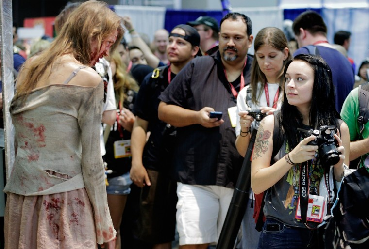 "A zombie character from the TV show ""The Walking Dead"" approaches the attendees during the 45th annual San Diego Comic-Con on July 24, 2014 in San Diego, California. An estimated 130,000 attendees are expected at this year's convention, which will celebrate the 75th anniversary of both Marvel Comics and the first Batman comic book. (T.J. Kirkpatrick/Getty Images)"