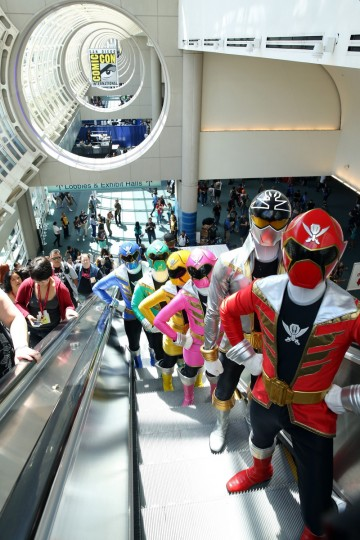 The Power Rangers Super Megaforce ride up the escalator at Comic-Con International 2014 on July 24, 2014 in San Diego, California. (Chelsea Lauren/Getty Images)