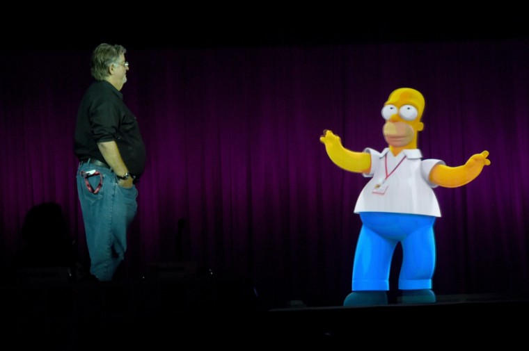 "Writer/producer Matt Groening with projection of Homer Simpson during FOX's ""The Simpsons"" panel during Comic-Con International 2014 at San Diego Convention Center on July 26, 2014 in San Diego, California. (Photo by Ethan Miller/Getty Images)"