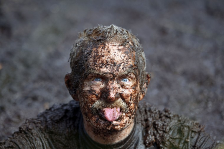 A male entrant takes a dip in the so called Bog Jacuzzi after takes part in the Irish Bog Snorkelling championship this afternoon at Peatlands Park on July 27, 2014 in Dungannon, Northern Ireland. The annual event sees male and female competitors swim the 60m length of the bog watched by scores of spectators and takes place on International Bog Day. (Charles McQuillan/Getty Images)