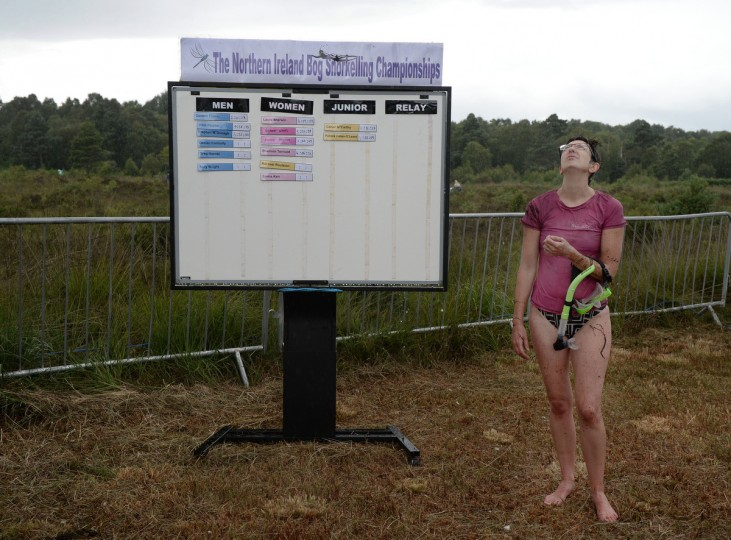 An entrant looks skyward at the falling rain after takes part in the Irish Bog Snorkelling championship this afternoon at Peatlands Park on July 27, 2014 in Dungannon, Northern Ireland. The annual event sees male and female competitors swim the 60m length of the bog watched by scores of spectators and takes place on International Bog Day. (Charles McQuillan/Getty Images)