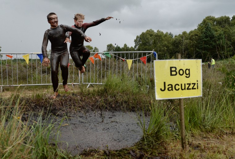 Patrick Colan-O'Leary (L) and Conor McCarthy (R) take a dip in the Bog Jacuzzi after takes part in the Irish Bog Snorkelling championship this afternoon at Peatlands Park on July 27, 2014 in Dungannon, Northern Ireland. The annual event sees male and female competitors swim the 60m length of the bog watched by scores of spectators and takes place on International Bog Day. (Charles McQuillan/Getty Images)