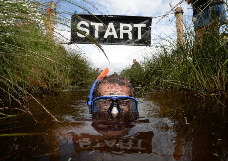 Stephen McDonagh takes part in the Irish Bog Snorkelling championship at Peatlands Park on July 27, 2014 in Dungannon, Northern Ireland. The annual event sees male and female competitors swim the 60m length of the bog watched by scores of spectators and takes place on International Bog Day. (Charles McQuillan/Getty Images)