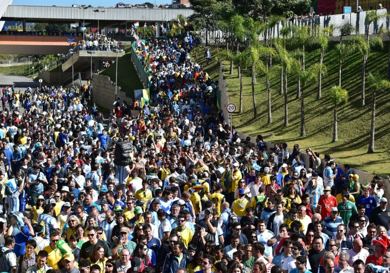 Supporters gather ahead of the Round of 16 football match between Argentina and Switzerland outside The Corinthians Arena in Sao Paulo on July 1, 2014,during the 2014 FIFA World Cup. (Nelson Almeida/Getty Images)