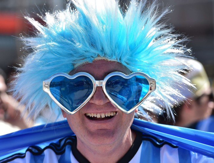 An Argentinian supporter poses ahead of the Round of 16 football match between Argentina and Switzerland outside The Corinthians Arena in Sao Paulo on July 1, 2014, during the 2014 FIFA World Cup. (Nelson Almeida/Getty Images)