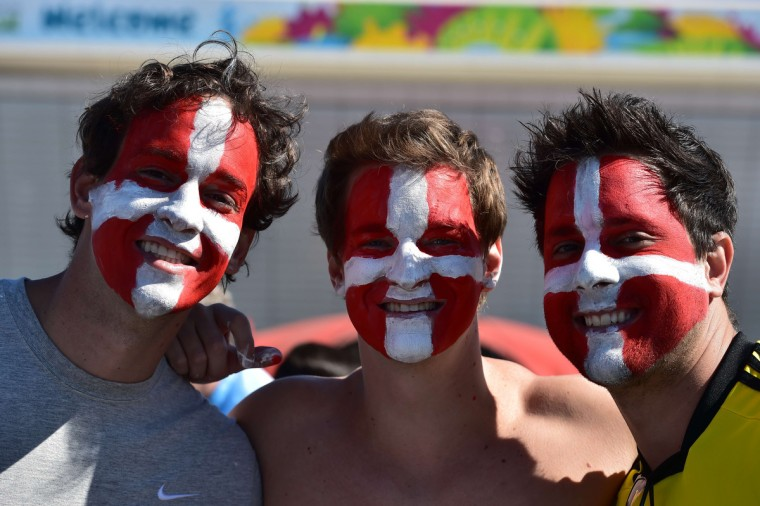 Switzerland's supporters pose ahead of the Round of 16 football match between Argentina and Switzerland outside The Corinthians Arena in Sao Paulo on July 1, 2014, during the 2014 FIFA World Cup. (Nelson Almeida/Getty Images)