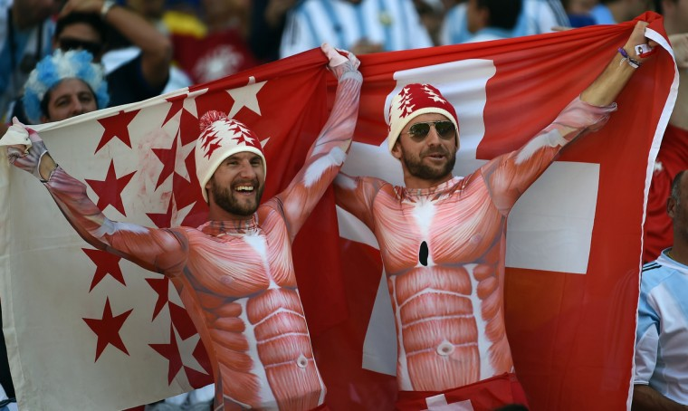 Switzerland fans cheer prior to the Round of 16 football match between Argentina and Switzerland at the Corinthians Arena in Sao Paulo during the 2014 FIFA World Cup on July 1, 2014. (Anne-Christine Poujoulat/Getty Images)