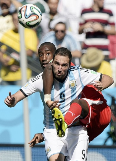 Switzerland's defender Johan Djourou (L) and Argentina's forward Gonzalo Higuain (front) vie for the ball during a Round of 16 football match between Argentina and Switzerland at Corinthians Arena in Sao Paulo during the 2014 FIFA World Cup on July 1, 2014. (Juan Mabromata/Getty Images)