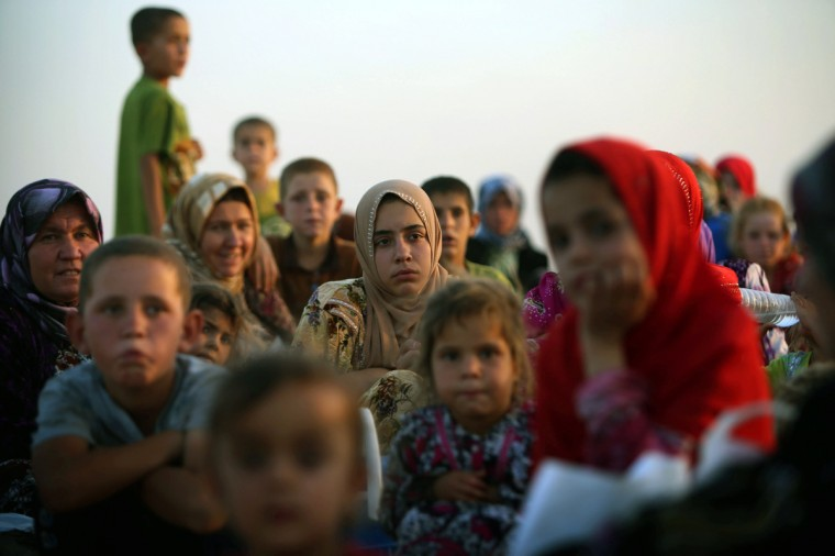 Iraqi families fleeing violence in the northern city of Tal Afar, arrive at the Kurdish checkpoint in Aski kalak, 40 km West of Arbil, in the autonomous Kurdistan region. Saudi Arabia pledged $500 million in humanitarian aid for Iraq to be disbursed through the United Nations to those in need regardless of sect or ethnicity, state media reported. (Safin Hamed/Getty Images)