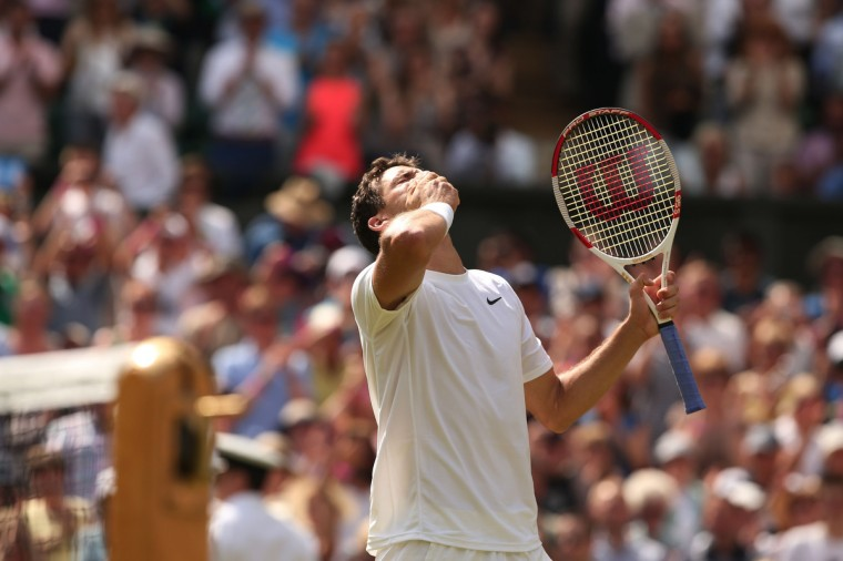 Bulgaria's Grigor Dimitrov celebrates winning his men's singles quarter-final match against Britain's Andy Murray on day nine of the 2014 Wimbledon Championships at The All England Tennis Club in Wimbledon, southwest London. (Andrew Cowie/Getty Images)