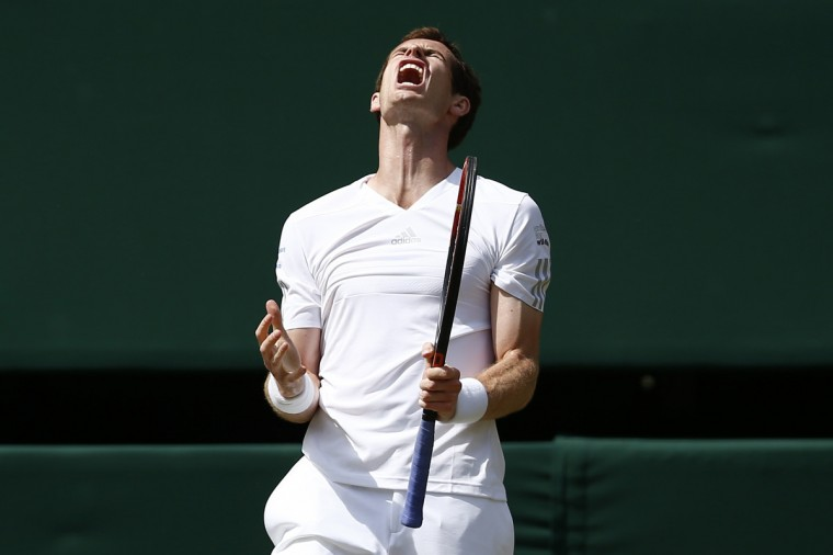 Britain's Andy Murray reacts to losing a point against Bulgaria's Grigor Dimitrov during their men's singles quarter-final match on day nine of the 2014 Wimbledon Championships at The All England Tennis Club in Wimbledon, southwest London. (Andrew Cowie/Getty Images)