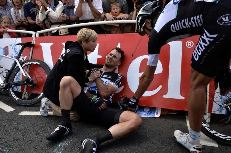 Britain's Mark Cavendish injured receives medical assistance after a fall near the finish line at the end of the 190.5 km first stage of the 101st edition of the Tour de France cycling race on July 5, 2014 between Leeds and Harrogate, northern England. The 2014 Tour de France gets underway on July 5 in the streets of Leeds and ends on July 27 down the Champs-Elysees in Paris. (Jeff Pachoud/Getty Images)