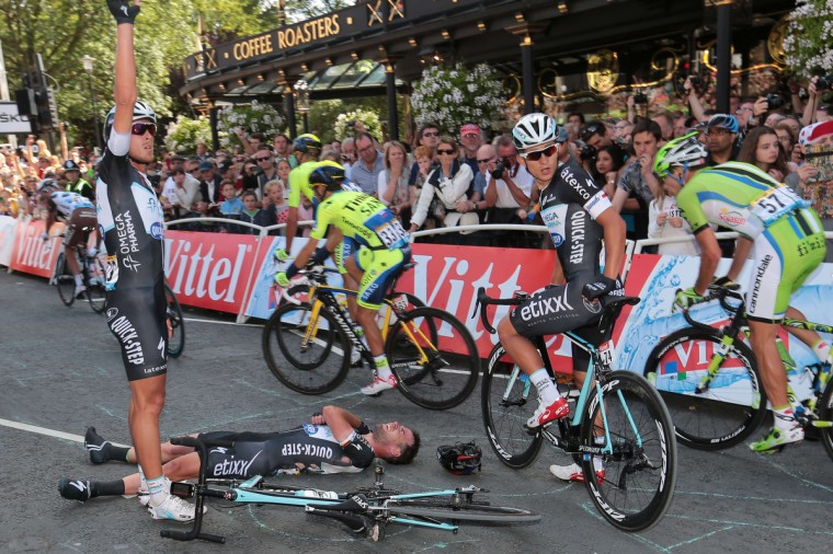 Britain's Mark Cavendish lies injured after a fall near the finish line at the end of the 190.5 km first stage of the 101st edition of the Tour de France cycling race on July 5, 2014 between Leeds and Harrogate, northern England. The 2014 Tour de France gets underway on July 5 in the streets of Leeds and ends on July 27 down the Champs-Elysees in Paris. (Fred Mons/Getty Images)