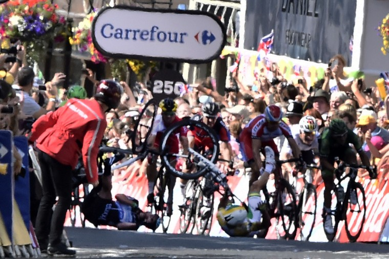 Australia's Simon Gerrans and Britain's Mark Cavendish fall near the finish line at the end of the 190.5 km first stage of the 101st edition of the Tour de France cycling race on July 5, 2014 between Leeds and Harrogate, northern England. The 2014 Tour de France gets underway on July 5 in the streets of Leeds and ends on July 27 down the Champs-Elysees in Paris. (Lionel Bonaventure/Getty Images)