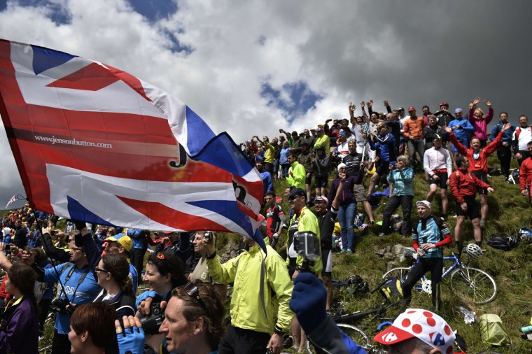 Supporters are pictured along the road during the 190.5 km first stage of the 101st edition of the Tour de France cycling race on July 5, 2014 between Leeds and Harrogate, northern England. The 2014 Tour de France gets underway on July 5 in the streets of Leeds and ends on July 27 down the Champs-Elysees in Paris. (Jeff Pachoud/Getty Images)