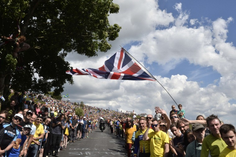Supporters are pictured along the road during the 201 km second stage of the 101th edition of the Tour de France cycling race on July 6, 2014 between York and Sheffield, northern England. (Jeff Pachoud/Getty Images)