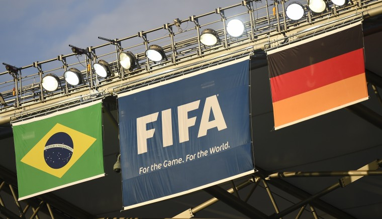 Germany's (R) and Brazil's (L) flags are displayed next to the FIFA flag at The Mineirao Stadium in Belo Horizonte on July 7, 2014 on the eve of the 2014 FIFA World Cup semi-final between Germany and Brazil. (Odd Andersen/AFP/Getty Images)