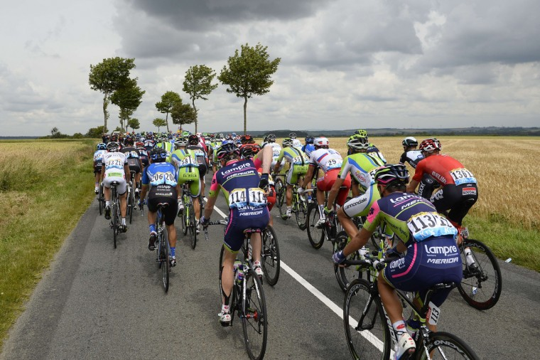 The pack rides during the 163.5 km fourth stage of the 101st edition of the Tour de France cycling race on July 8, 2014 between Le Touquet-Paris-Plage and Lille, nothern France. (Eric Feferberg/Getty Images)