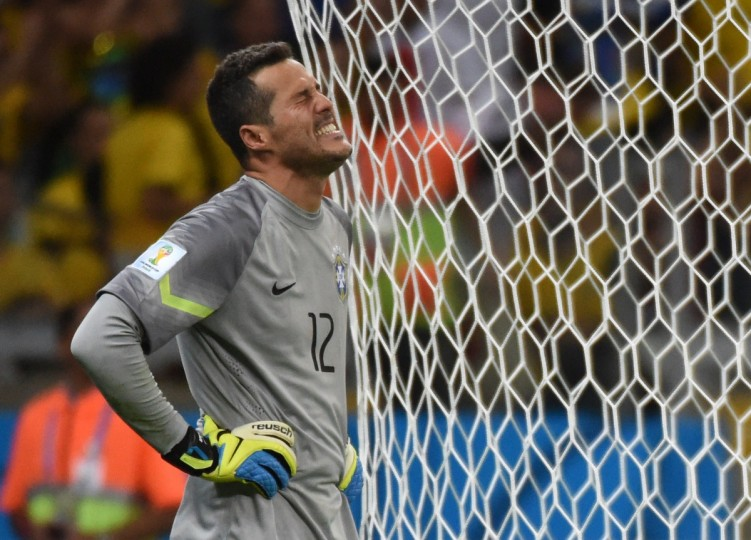 Brazil's goalkeeper Julio Cesar reacts after goal number seven during the semi-final football match between Brazil and Germany at The Mineirao Stadium in Belo Horizonte on July 8, 2014, during the 2014 FIFA World Cup. (Christophe Simon/Getty Images)