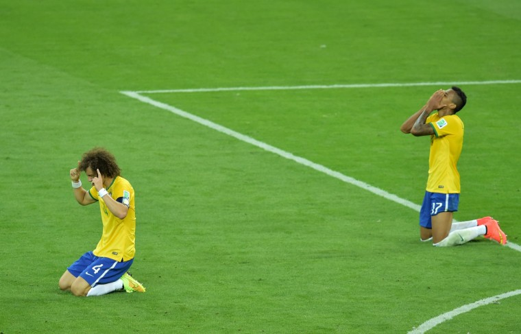Brazil's defender David Luiz and Brazil's midfielder Luiz Gustavo react after losing the semi-final football match between Brazil and Germany at The Mineirao Stadium in Belo Horizonte on July 8, 2014, during the 2014 FIFA World Cup. (Gabriel Bouys/Getty Images)