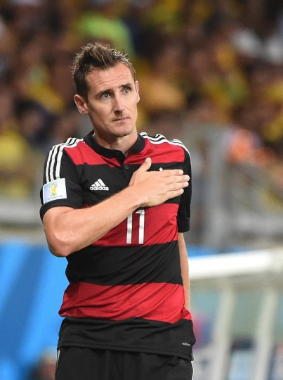 Germany's forward Miroslav Klose celebrates after scoring their second goal during the semi-final football match between Brazil and Germany at The Mineirao Stadium in Belo Horizonte on July 8, 2014, during the 2014 FIFA World Cup. (Patrik Stollarz/Getty Images)