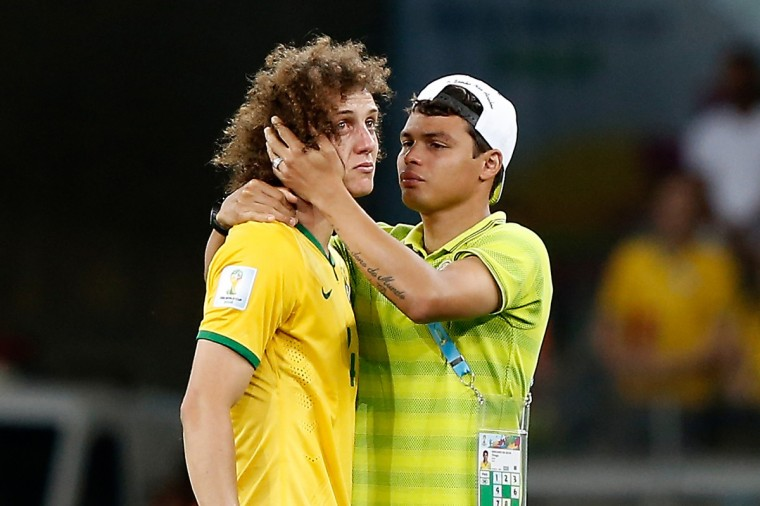 Brazil's defender Thiago Silva (R) conforts Brazil's defender David Luiz after the semi-final football match between Brazil and Germany at The Mineirao Stadium in Belo Horizonte during the 2014 FIFA World Cup on July 8, 2014. (Adrian Dennis/Getty Images)