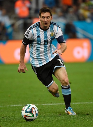 Argentina's forward and captain Lionel Messi runs with the ball during the semi-final football match between Netherlands and Argentina of the FIFA World Cup at The Corinthians Arena in Sao Paulo on July 9, 2014. (Pedro Ugarte/Getty Images)