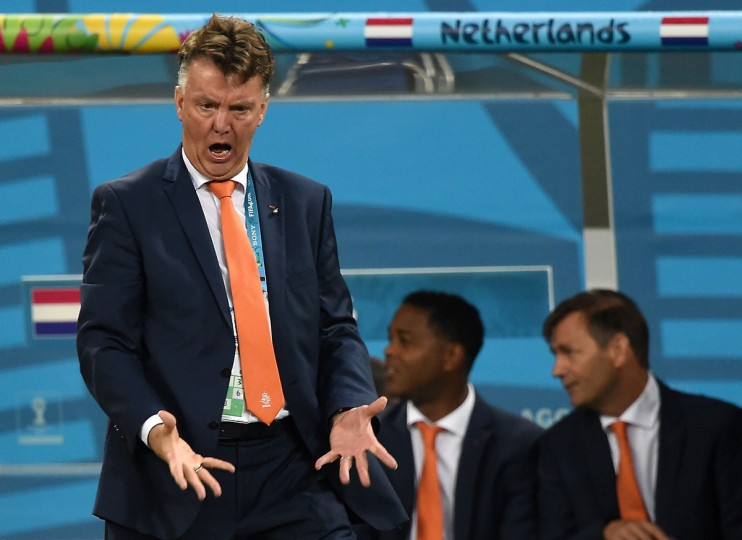 Netherlands' coach Louis van Gaal (L) gestures during the semi-final football match between Netherlands and Argentina of the FIFA World Cup at The Corinthians Arena in Sao Paulo on July 9, 2014. (Pedro Ugarte/Getty Images)