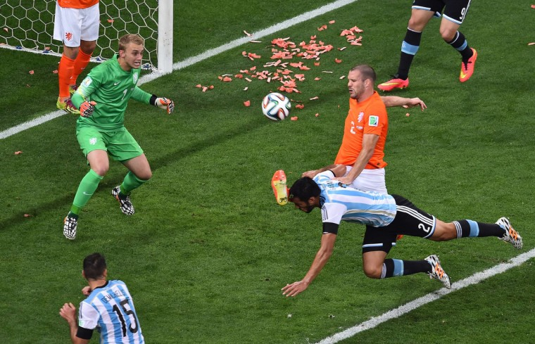 Argentina's defender Ezequiel Garay (C) heads the ball during the semi-final football match between Netherlands and Argentina of the FIFA World Cup at The Corinthians Arena in Sao Paulo on July 9, 2014. (Gabriel Bouys/Getty Images)