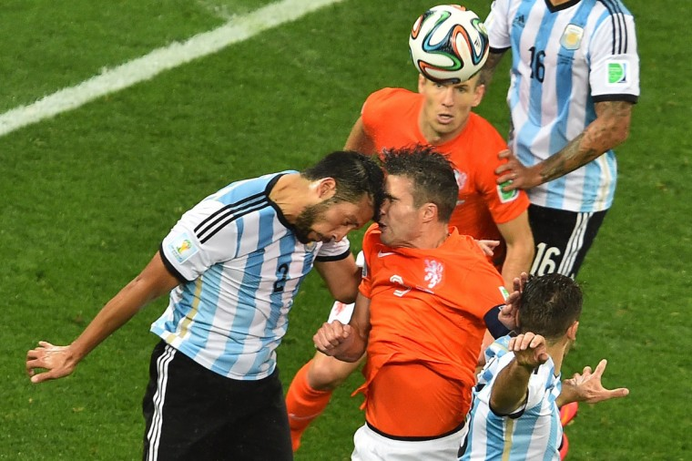Argentina's defender Ezequiel Garay (L) vies with Netherlands' forward Robin van Persie (R) during the semi-final football match between Netherlands and Argentina of the FIFA World Cup at The Corinthians Arena in Sao Paulo on July 9, 2014. (Gabriel Bouys/Getty Images)