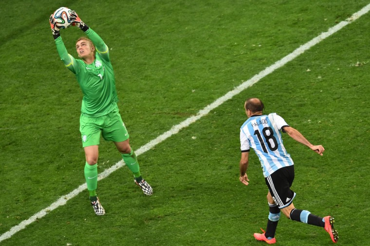 Argentina's forward Rodrigo Palacio (R) makes a failed attempt at goal as Netherlands' goalkeeper Jasper Cillessen (L) catches the ball during extra time of the semi-final football match between Netherlands and Argentina of the FIFA World Cup at The Corinthians Arena in Sao Paulo on July 9, 2014. (Gabriel Bouys/Getty Images)