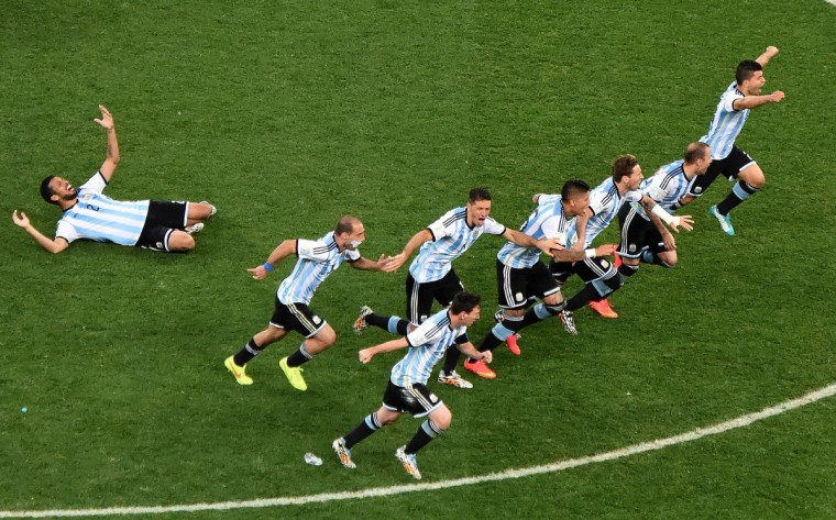 Argentinian players celebrate after winning the semi-final football match between Netherlands and Argentina of the FIFA World Cup at The Corinthians Arena in Sao Paulo on July 9, 2014. (Christophe Simon/Getty Images)