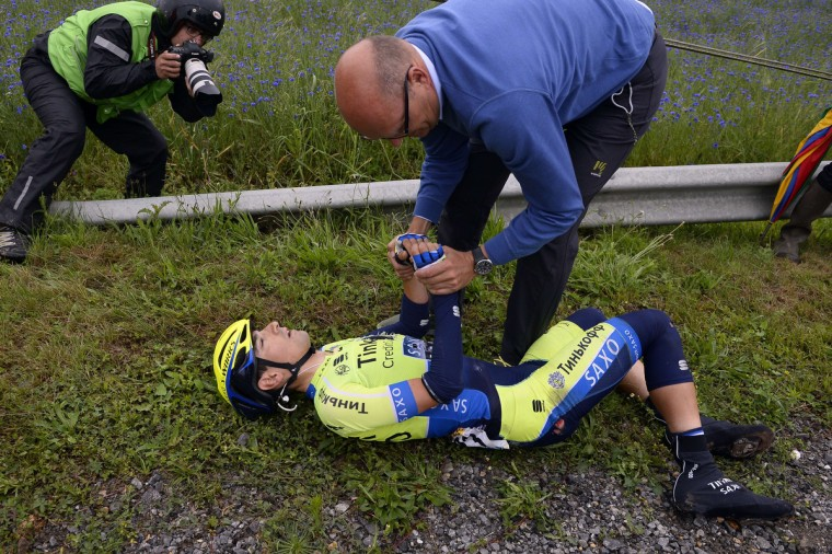 Spain's Jesus Hernandez Blazquez receives medical assistance after a fall during the 194 km sixth stage of the 101st edition of the Tour de France cycling race on July 10, 2014 between Arras and Reims, northern France. (Eric Feferberg/Getty Images)