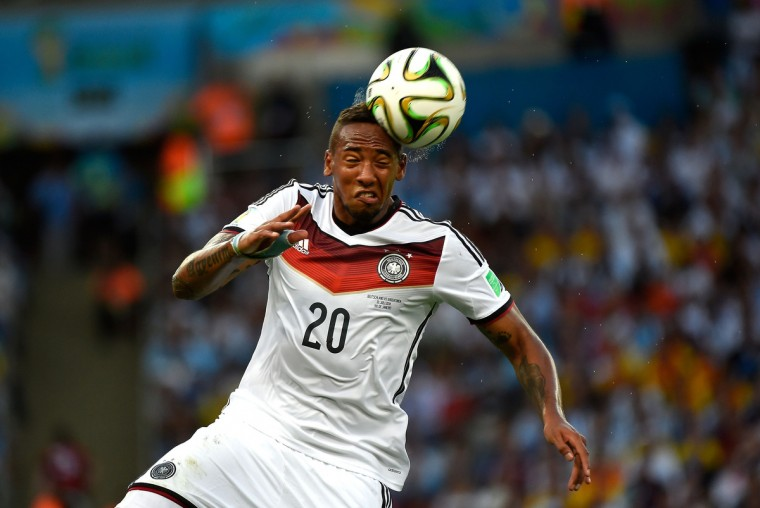 Germany's defender Jerome Boateng heads the ball during the 2014 FIFA World Cup final football match between Germany and Argentina at the Maracana Stadium in Rio de Janeiro on July 13, 2014. (Odd Andersen/Getty Images)