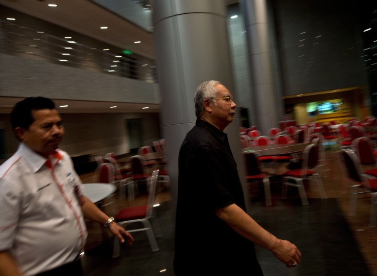 Malaysian Prime Minister Najib Razak leaves the Airport Management building at the Kuala Lumpur International Airport in Sepang. A Malaysian airliner, carrying 295 people from Amsterdam to Kuala Lumpur, crashed on July 17 near the town of Shaktarsk, in rebel-held east Ukraine. Pro-Russian rebels fighting central Kiev authorities claimed on July 17 that the Malaysian airliner that crashed in Ukraine had been shot down by a Ukrainian jet. (Manan Vatsyayana/Getty Images)