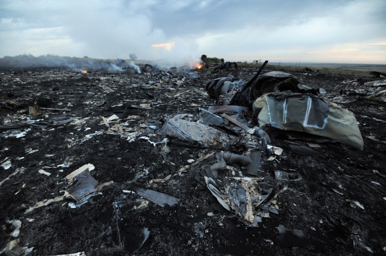 Flames are seen amongst the wreckages of the Malaysian airliner carrying 295 people from Amsterdam to Kuala Lumpur after it crashed, near the town of Shaktarsk, in rebel-held east Ukraine. Pro-Russian rebels fighting central Kiev authorities claimed on Thursday that the Malaysian airline that crashed in Ukraine had been shot down by a Ukrainian jet. (Dominique Faget/Getty Images)