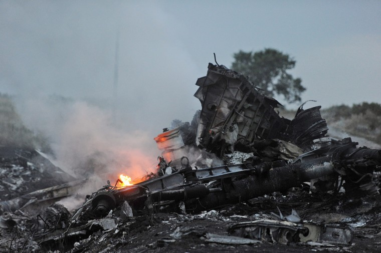 The wreckage of the Malaysian airliner carrying 295 people from Amsterdam to Kuala Lumpur is seen after it crashed, near the town of Shaktarsk, in rebel-held east Ukraine. Pro-Russian rebels fighting central Kiev authorities claimed on Thursday that the Malaysian airline that crashed in Ukraine had been shot down by a Ukrainian jet. The head of Ukraine's air traffic control agency said Thursday that the crew of the Malaysia Airlines jet that crashed in the separatist east had reported no problems during flight. (Dominique Faget/Getty Images)