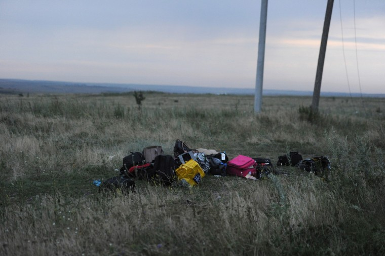 Luggage is seen at the site of the crash of the Malaysian airliner carrying 295 people from Amsterdam to Kuala Lumpur, near the town of Shaktarsk, in rebel-held east Ukraine. Pro-Russian rebels fighting central Kiev authorities claimed on Thursday that the Malaysian airline that crashed in Ukraine had been shot down by a Ukrainian jet. The head of Ukraine's air traffic control agency said Thursday that the crew of the Malaysia Airlines jet that crashed in the separatist east had reported no problems during flight. (Dominique Faget/Getty Images)