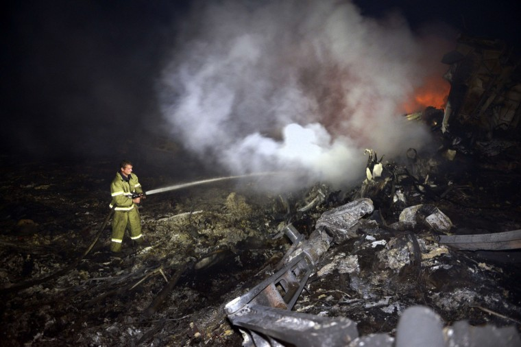 "Firefighters extinguish a fire, on July 17, 2014, amongst the wreckages of the malaysian airliner carrying 295 people from Amsterdam to Kuala Lumpur after it crashed, near the town of Shaktarsk, in rebel-held east Ukraine. Ukrainian President Petro Poroshenko said on Thursday that the Malaysia Airlines jet that crashed over rebel-held eastern Ukraine may have been shot down.""We do not exclude that the plane was shot down and confirm that the Ukraine Armed Forces did not fire at any targets in the sky,"" Poroshenko said in a statement posted on the president's website. (Alexander Khudoteply/Getty Images)"