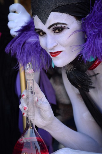 An attendee dressed as the Disney villain Yzma attends the first day of the 45th annual San Diego Comic-Con, in San Diego California July 24, 2014. The four-day pop culture extravaganza celebrates film, TV, video games, comic books, costumes and other popular arts. More than 150,000 fans are expected to attend the sold-out event. (Robyn Beck/Getty Images)