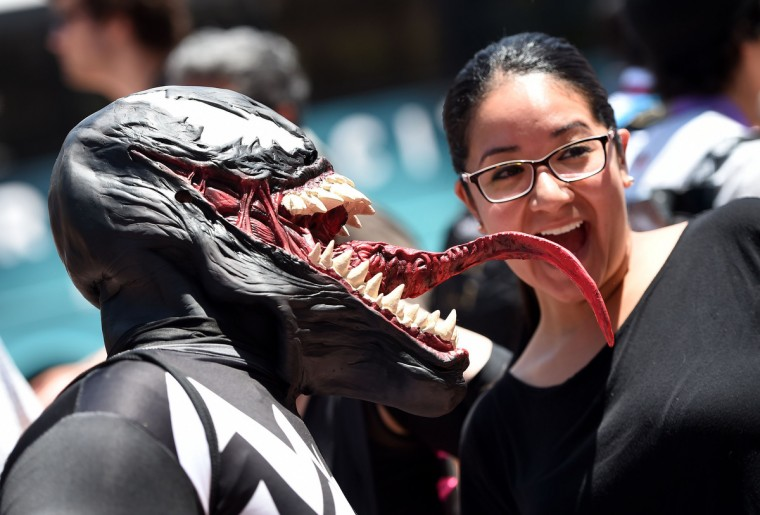 "Kaleb McDade, dressed as the Spiderman villian ""Venom,"" poses for photos outside the San Diego Convention Center on the third day of the 45th annual Comic-Con, in San Diego, California July 26, 2014. (Robyn Beck/Getty Images)"