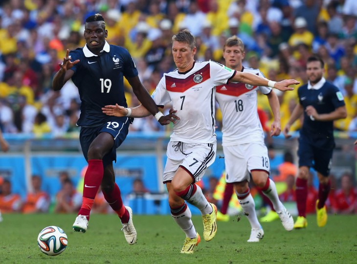 France's Paul Pogba (left) and Germany's Bastian Schweinsteiger fight for the ball during the World Cup quarerterfinal match Friday at Maracana Stadium in Rio de Janeiro. (Matthias Hangst/Getty Images)